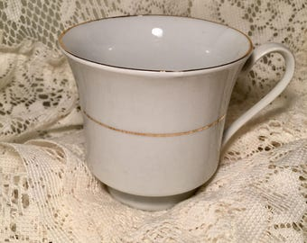 Sakura classic gold white tea cup with gold trim! Sold elswhere for 7-8 dollars!