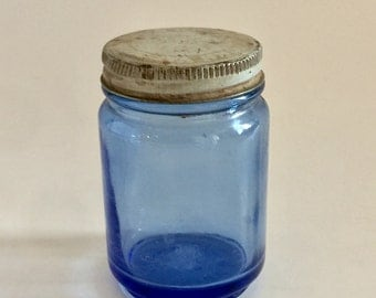 Vintage blue glass Vicks jar