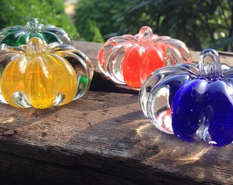Mini hand blown glass pumpkin paperweights in a variety of colors