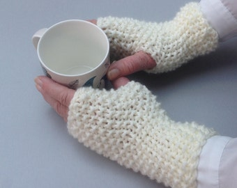 A pair of ladies' hand knitted wrist warmers/fingerless gloves. Soft, warm and cosy.