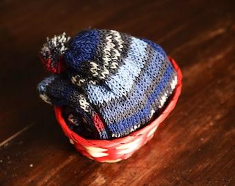 Knit scarf with pom poms