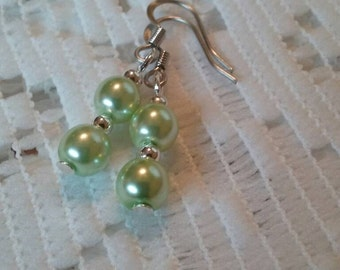 Light green pearls. Green pearls. Pastel green pearls. Light green earrings. Light green glass pearls on stainless steel french hooks.