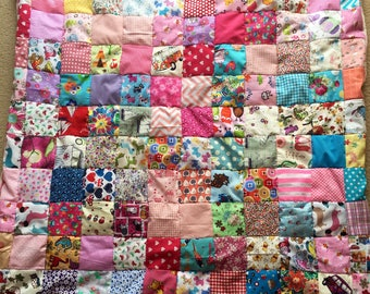 Beautiful fleece backed baby girl patchwork quilt
