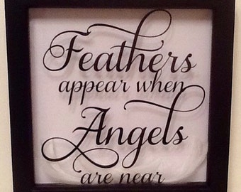Feathers appear when Angels are near box frame picture