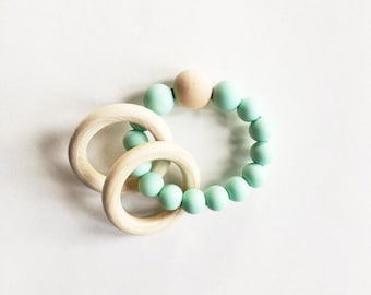Silicone baby teething ring rattle