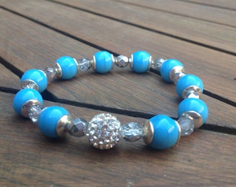 Beautiful women's bracelet with blue pearls and rhinestones