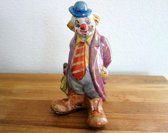 Vintage ceramic clown with umbrella money bank, coin bank, still bank, piggy bank