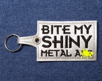 "Bite My Shiny Metal A** Key Chain – 4.5"" x 2.25"" Bite Me Keychain – Bite Me Key Chain – Bite Me Key Fob – Bite Me Keyring – Bite Me Key Ring"
