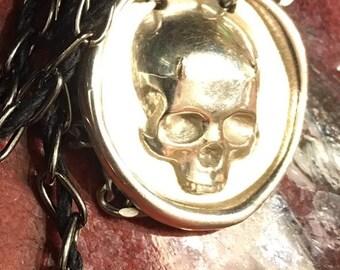 Horned skull pendant