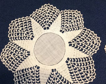 Pair of small vintage 8-pointed star thread crochet doilies in off-white, with circle centers.