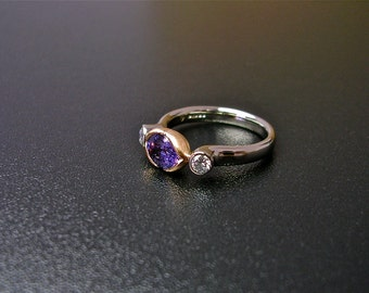 Purple sapphire and diamond three stone ring.