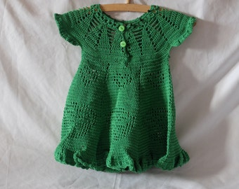 Crocheted baby dress in green
