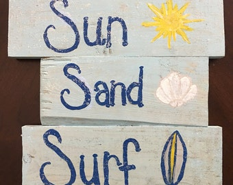 Sun sand surf sign
