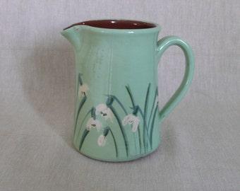 Handmade pottery snowdrop jug. Apple green snowdrop jug. Small milk jug