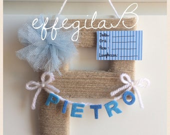 Initial letter wool pompom banner with name and tag birth