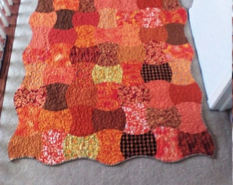 Orange applecore quilted throw