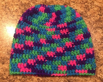 Crocheted bun hole hat