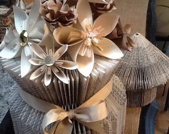 Book folded vase adorned with Oragami flowers and natural ribbon