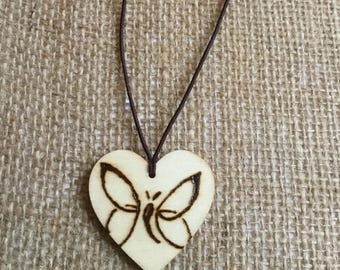 Wooden heart shaped butterfly pyrography pendant