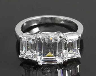 Emerald cut three stone ring .925 sterling silver AAAAA grade cubic zirconia
