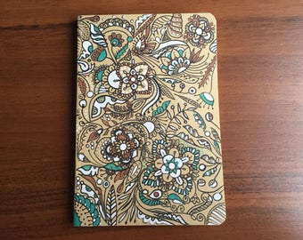 Notebook, decorated with a freehand drawing