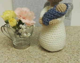 Crochet angel and baby boy figure.