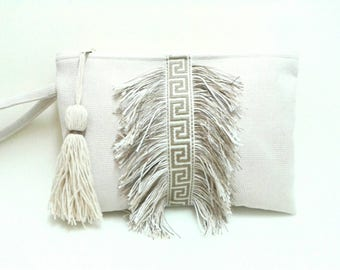 Boho chic wristlet clutch with grecian ribbon and fringes. Natural color summer purse. Greek style clutch with fringe.