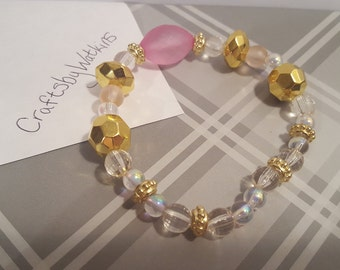 Pink and gold beaded stretchy bracelet A15