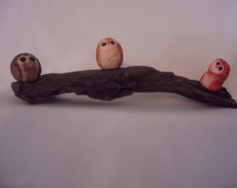 Tiny trio of owls on natural wood base