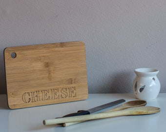 Cutting board with text cheese