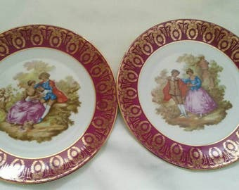 Set of 2 pink La Reine Limoges decorative A9 plates