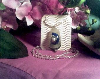 Bech Glass Neck piece. Shell, metal and glass beads.