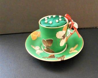 Pin Cushion Butterflies fluttering on Green Bone China Tea Cup