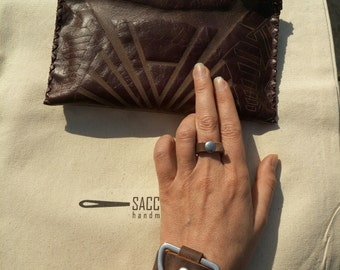 Brown leather clutch with texture