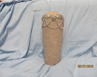 Long textured vase decorated with a chain