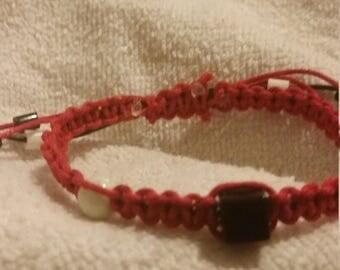 Black Acrylic Bead on Red Hemp Rope