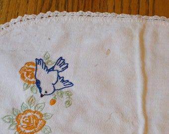small table runner with embroidered blue birds and orange flowers