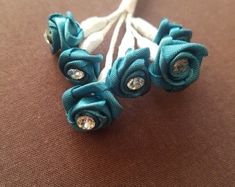 Teal rose wired flowers
