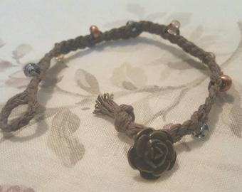 Braided hemp bracelet with vintage rose button