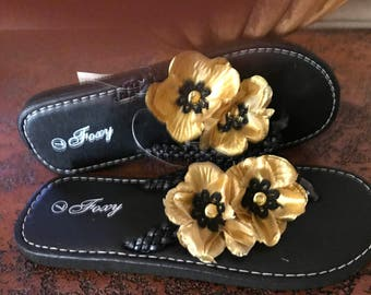 Hand embellished flip flops. Black/gold flowers. Size 7