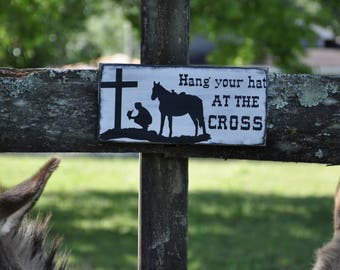 Hang your hat at the cross wood sign