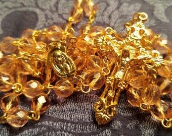 Peach Glass, Gold Plated Centerpiece and Cross Rosary