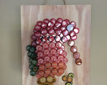 Seahorse beer bottle cap art with bottle opener.