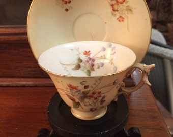 Antique Royal Worcester ivory blush cup and saucer