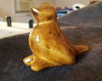 Scorched basswood stylized bird. Hand carved and finished