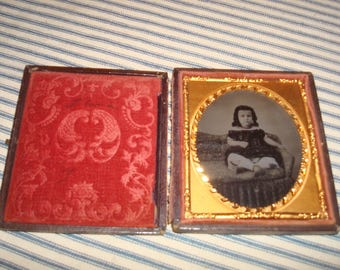 Ambrotype image of young girl sitting on a couch - Civil War period 1/6 plate image Very Nice