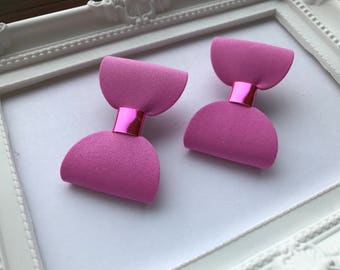 Pair of pink mini hair bow clips