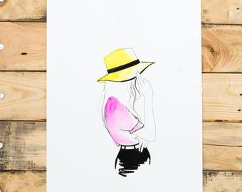 The girl with the yellow hat