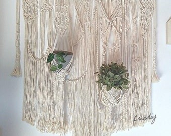 Headboard in macrame with supports plants