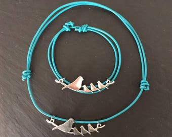 Blue leather bird on a wire necklace and bracelet set